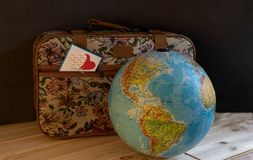 A small gobelin suitcase with a card in a pocket with a picture of hearts stock photography