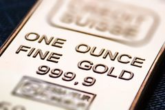 The small gold bar is one ounce. royalty free stock photos