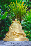 A small gold pagoda in a temple Stock Images