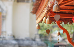 Small golden bells hanging under roof Royalty Free Stock Photography