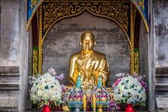 A small golden Buddha in pagoda at `Wat Den Salee Sri Muang Gan Wat Ban Den`. royalty free stock photos
