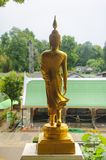 Small golden Buddha statue. Small golden plated Buddha statue in a Buddhist temple in Koh Samui, Thailand royalty free stock photo