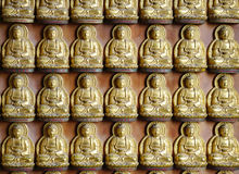 Small Golden chinese style buddha sculpture at Wat Borom Raja Ka Royalty Free Stock Photos