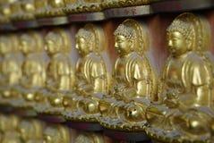 Small Golden chinese style buddha sculpture at Wat Borom Raja Ka Royalty Free Stock Image