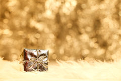 Small golden giftbox Stock Photography
