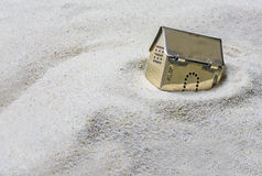 Free Small Golden Model House Sinking Into The Sand, Concept Of Risk Stock Photography - 59337092
