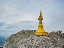 Small Golden pagoda on `Phuka ` at Khao Luang mountain Ramkhamhaeng National Park. Sukhothai province Thailand royalty free stock photography