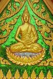 Small golden Buddha statue. Small golden plated Buddha statue in a Buddhist temple in Koh Samui, Thailand stock photo
