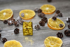 Small golden present with decorative cones Stock Images