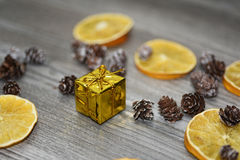 Small golden present with decorative cones Stock Image