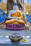 Small Buddha statue in a temple. Small golden statue of Buddha in a corner of a Buddhist temple stock images