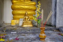 Small Buddha statue in a temple. Small golden statue of Buddha in a corner of a Buddhist temple royalty free stock photography