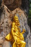 Small golden statue. Small golden plated statue in a Buddhist temple in Koh Samui, Thailand stock image