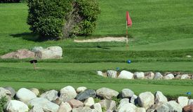 Small Golf Course. View of small golf course with starting point of one hole and flag of another Stock Photo
