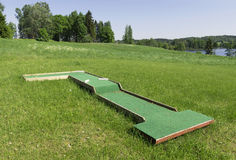 Small golf course built for children in a recreational space. Stock Image