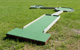 Small golf course built for children in a recreational space. Royalty Free Stock Photography