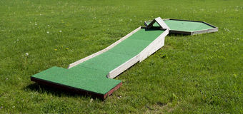 Small golf course built for children in a recreational space. Stock Photo