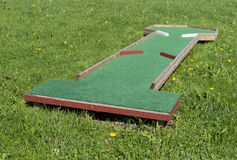 Small golf course built for children in a recreational space. Stock Photos