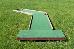 Small golf course built for children in a recreational space. Royalty Free Stock Photo