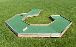 Small golf course built for children in a recreational space. Royalty Free Stock Images