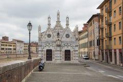 Small gothic church Santa Maria della Spina near the river Arno in Pisa, Italy. Cloudy, rainy weather. Pisa, Italy.  royalty free stock image
