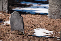 Small Gravestone. A Small Gravestone with Snow on the Ground stock photo