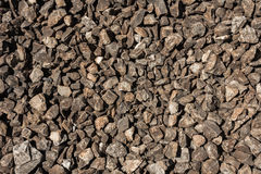 Small gray and brown stones on a ground. Stock Photo