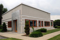 Small Gray Business Building. Corner of a small gray business building with overcast day Stock Photos