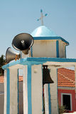 Small Greek bell tower with loudspeakers Royalty Free Stock Images
