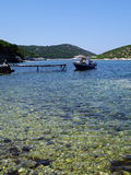 Small Greek Boat Moored in Bay Royalty Free Stock Images