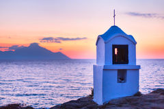 Small greek chapel and mount Athos at sunrise or sunset with sea panorama Royalty Free Stock Photos