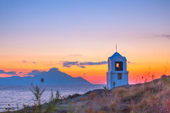 Small greek chapel and mount Athos at sunrise or sunset with sea panorama Stock Images