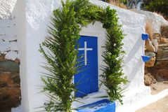 Small greek chaple with plants Royalty Free Stock Image