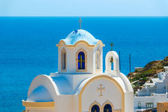 Small Greek church with blue dome Royalty Free Stock Photos