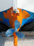 Small Greek Fishing Boat, Annual Maintenance. Detail of a small hand-made wooden Greek fishing boat, or caique, undergoing annual maintenance for the summer Stock Image