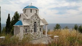 Small Greek temple on the hill near Aegean Sea stock footage