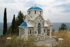 Small Greek temple on the hill near Aegean Sea. Small Greek temple on the hill near the Aegean Sea, Loutra, Greece royalty free stock photos