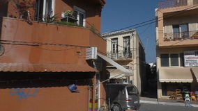Small Greek town view through bus window. Passenger window view from the bus travelling through Greek town stock footage