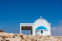 Small Greek white chapel with a blue roof Stock Photos