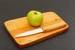 Small green apple and knife Stock Image