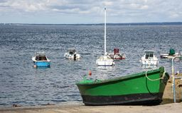 Green Boat on the shoreline. A small green boat on the shoreline Royalty Free Stock Images