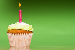 Small green cake with a single candle Royalty Free Stock Image