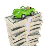 Small green car on a big pack of dollars. Royalty Free Stock Photography