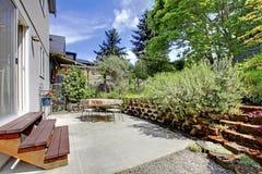 Small green fenced back yard with garden stock photos