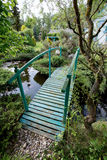 Small green footbridge over a pond Royalty Free Stock Photos