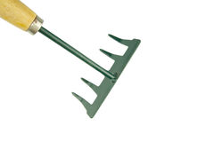 Small green harrow with wooden handle placed top left isolated Royalty Free Stock Image