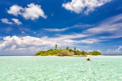 Small island in ocean on Maldives royalty free stock photography