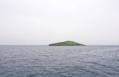 Small green islet Stock Photography