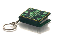 Small green key-ring book Royalty Free Stock Images
