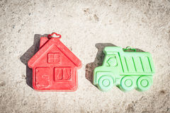 Small green machine and red house on a brown background. Child toys green machine and red house on a brown background. Toy background concept stock image